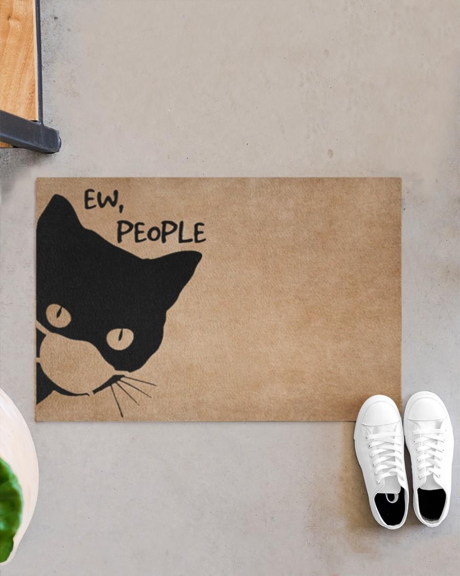 Cat ew people doormat