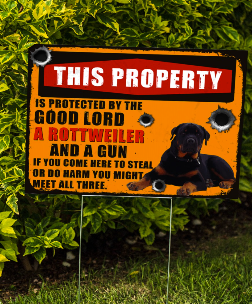 This property is protected by the good lord a rottweiler and a gun yard sign 1