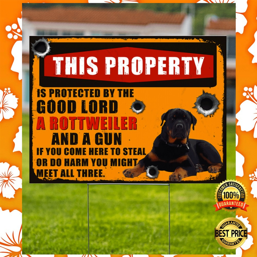 This property is protected by the good lord a rottweiler and a gun yard sign2