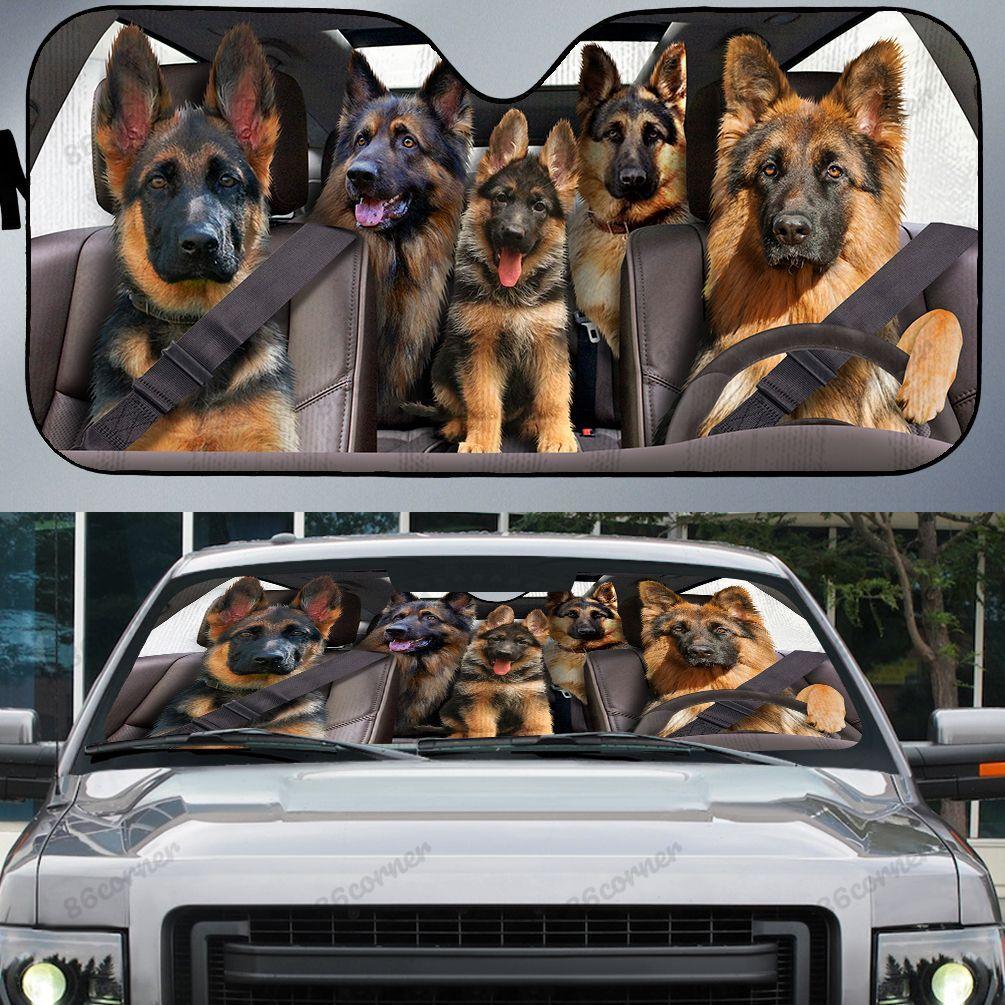 German Shepherd family driving car sunshade - Picture 1